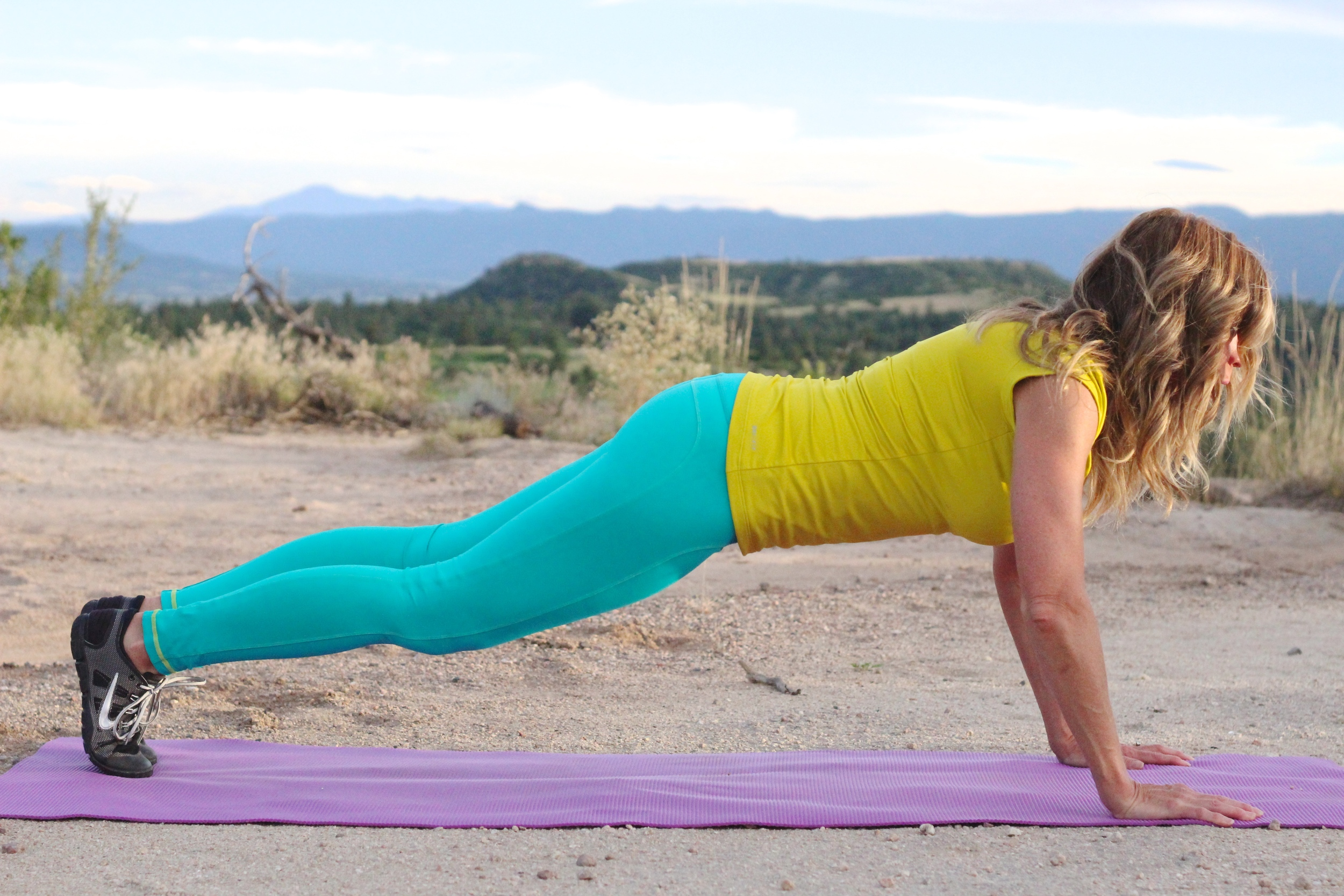 In Plank position getting ready to do Mountain Climbers, to strengthen the abs.