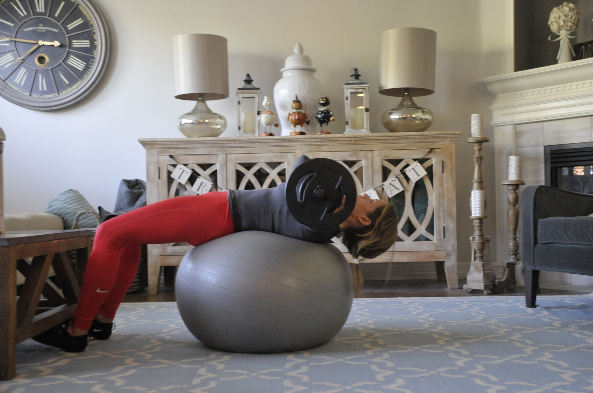 Get full extension as you go back on the yoga ball.