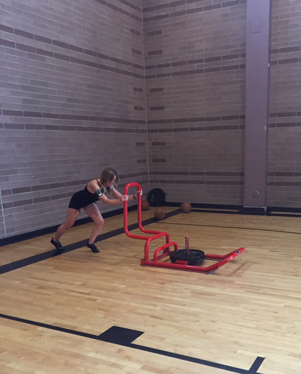 Sled Push with 90 lbs. - add in more weight to add challenge.