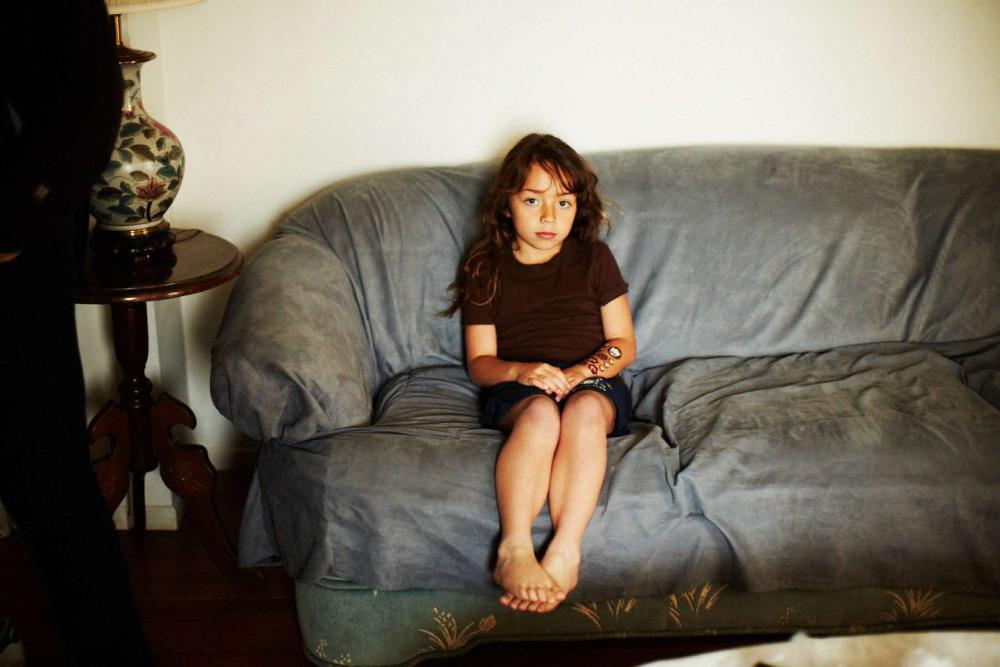 dxthm1000.520cf02aaadeb_Christian_Kozowyk_young_girl_on_couch.jpg