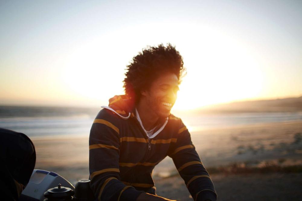 dxthm1000.570bb4b5e6778_Christian_Kozowyk_man_beach_sunset.jpg