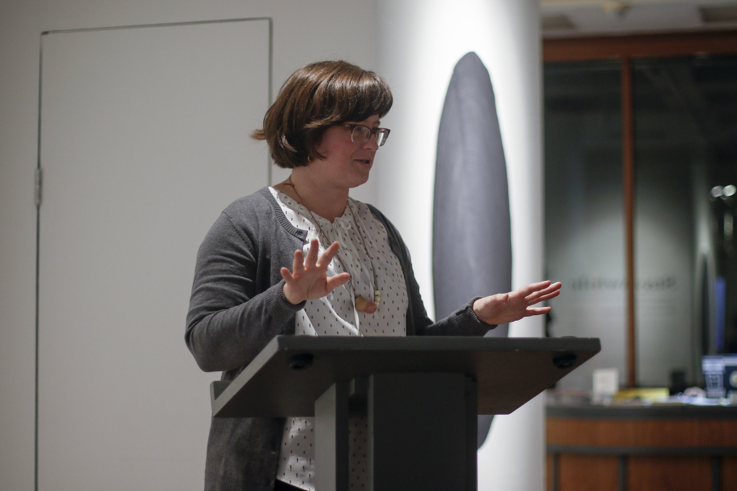 Gallery Director, Mara Baldwin, talks to the audience before an artist talk.