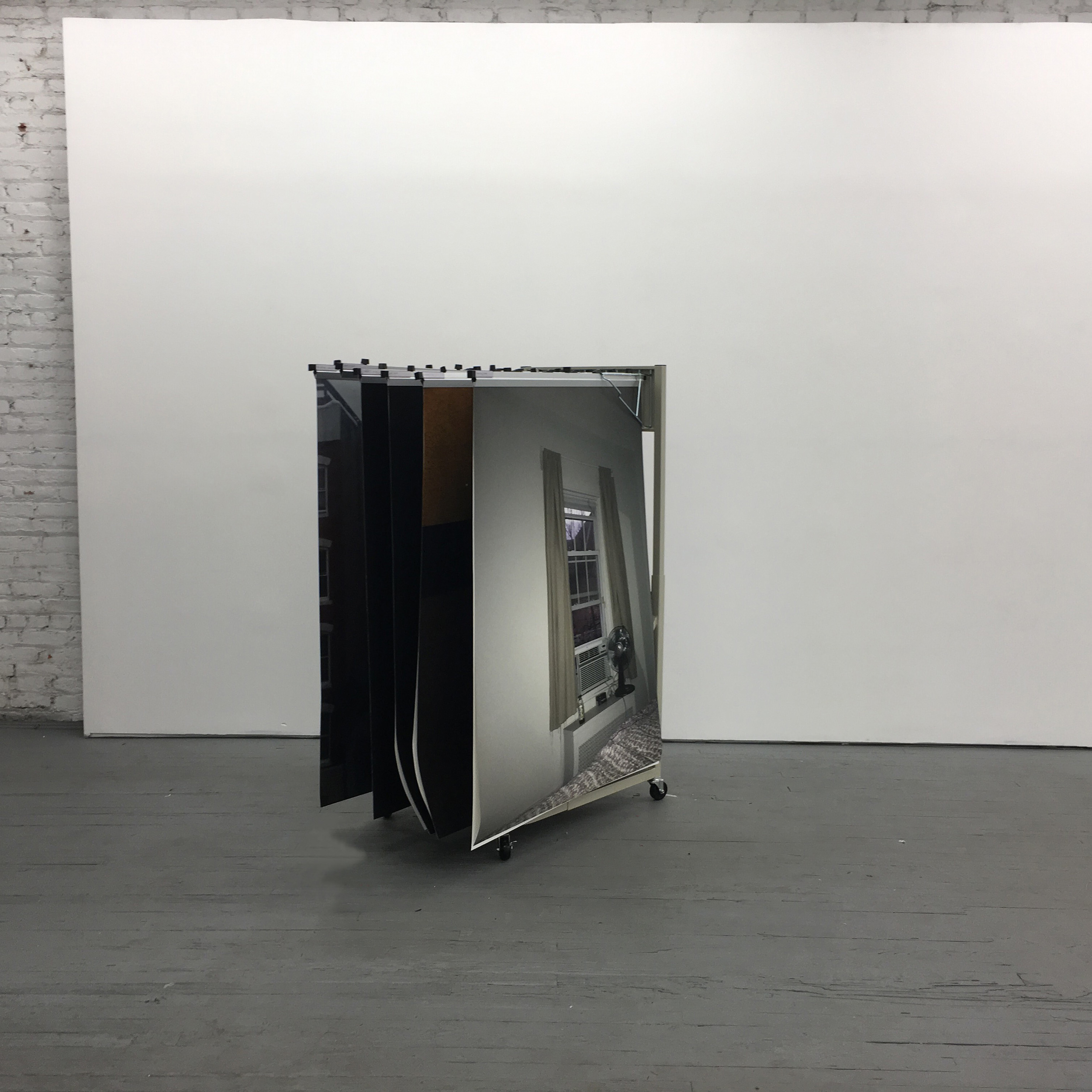 """Soft Archive; Volume I     2016  Installation comprised of large format archival inkjet prints, hanging on steel blueprint rack.  On the back of the rack there is a small brass label with title """"Soft Archive"""""""