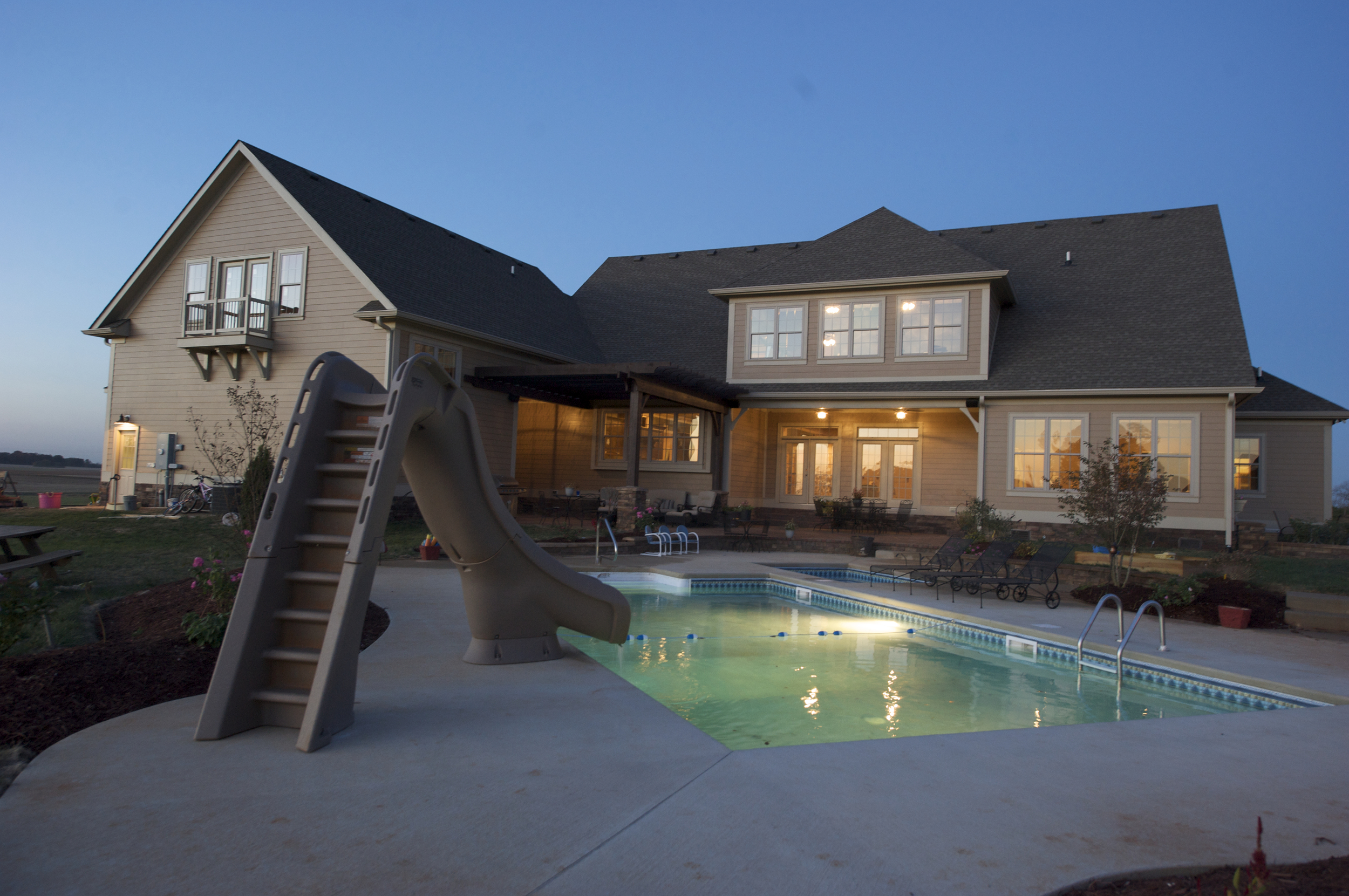 Providence Homes can design your outdoor living with fire-pits, pools, fireplaces and distinctive landscaping.