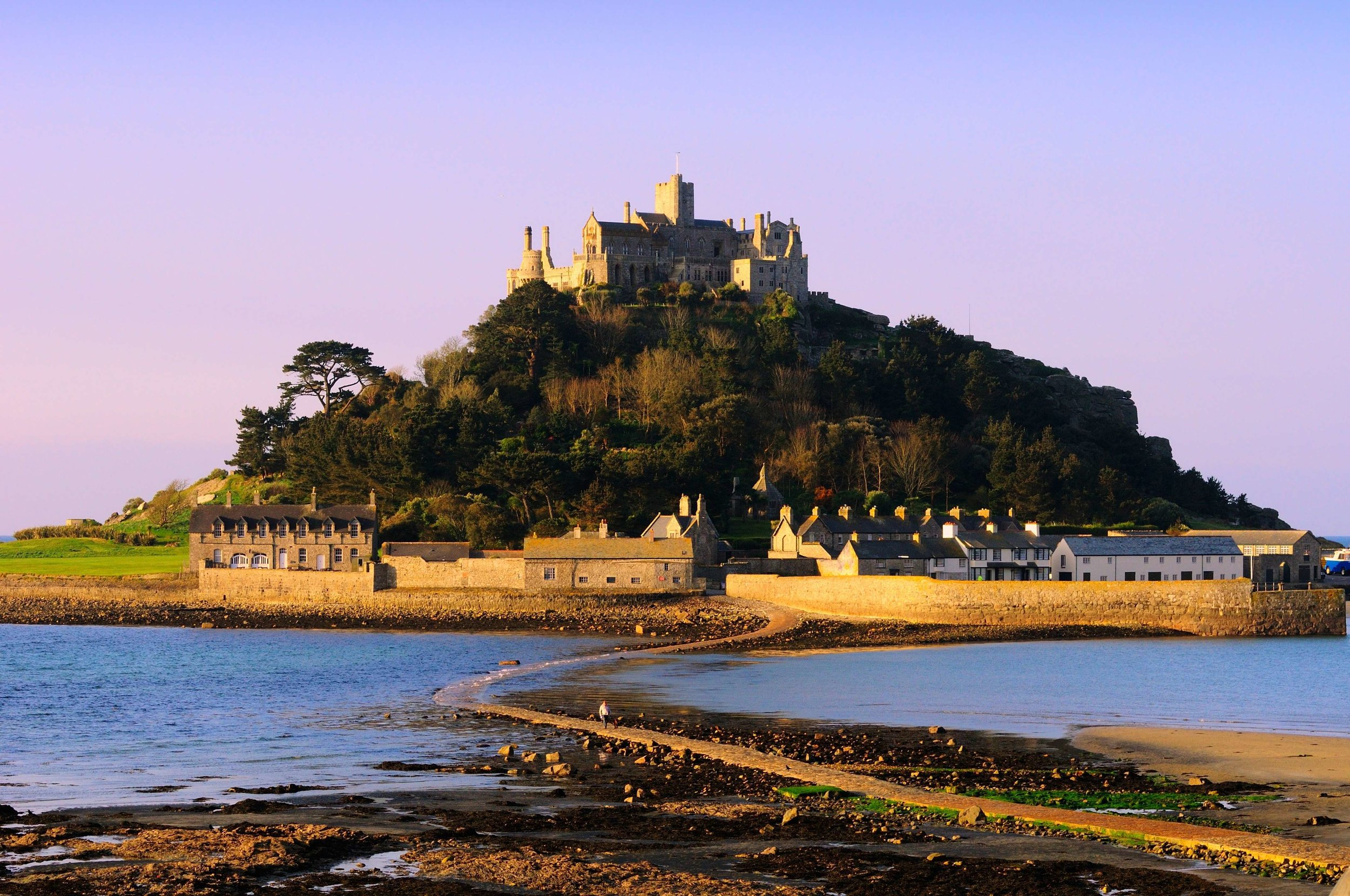 1. St. Michael's Mount - St. Michael's mount is an unmissable sight from wherever you are in Marazion. The iconic Cornish landmark that sits in Mount's bay is a bastion from Cornwall's past and has existed in some sense since the 11th century.You can explore the castle during the day and learn of its storied past from religious roots to times of siege.The Mount's gardens offer a unique climate as they beautifully display rare, sub-tropical plants and flowers that cling to the terraced granite slopes.