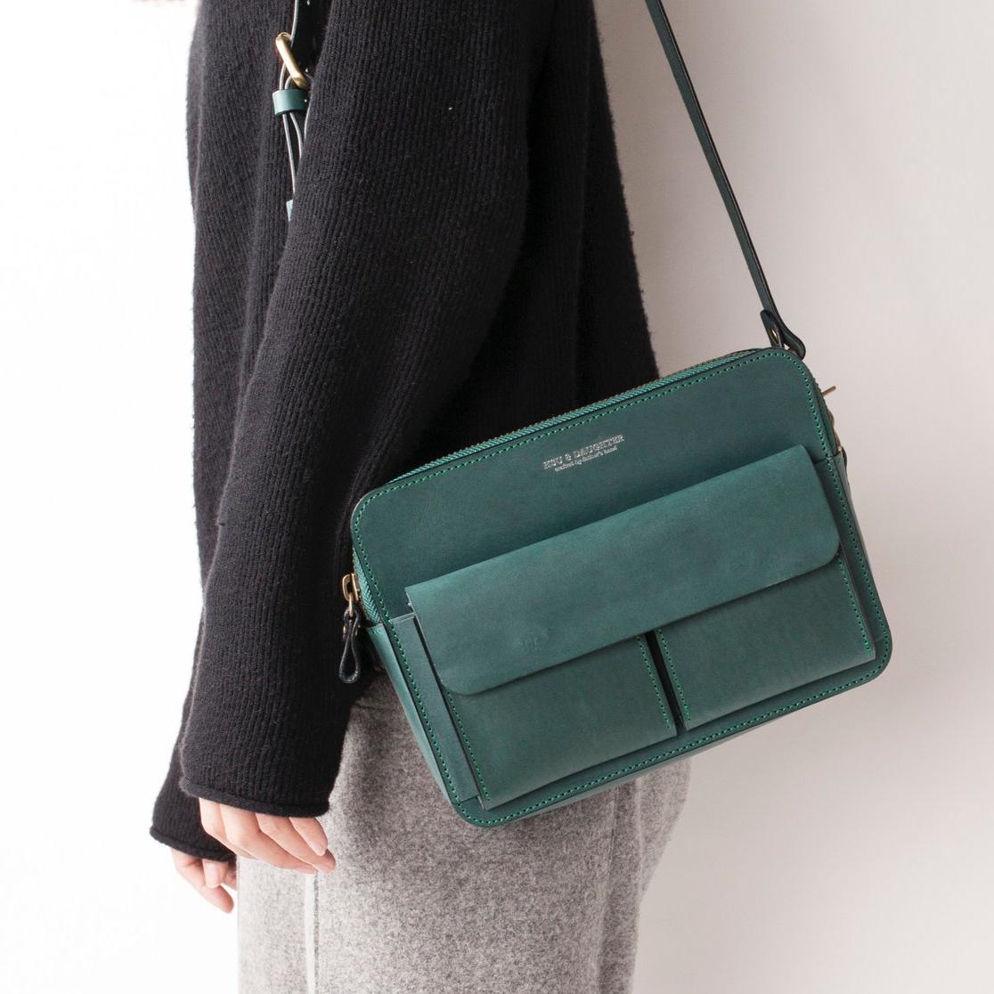 雙前袋側背包