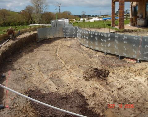 Excavation and walls being formed