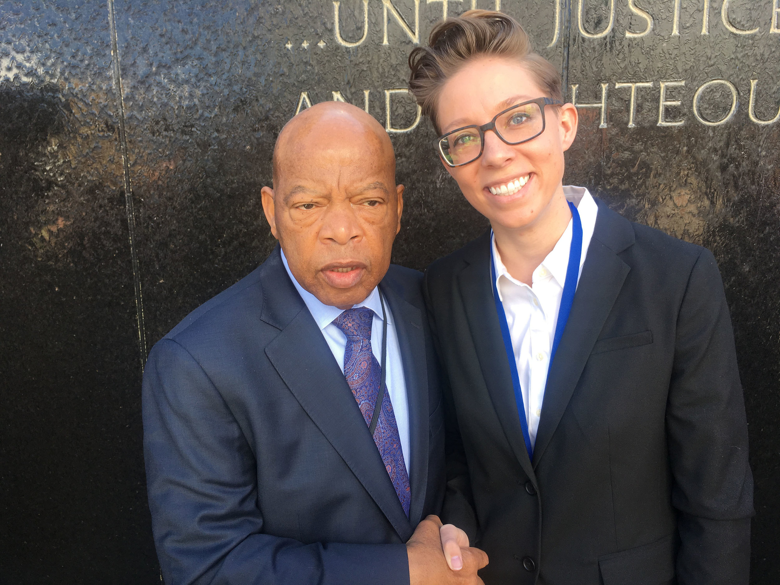 Janelle Cronk shakes hands with Rep. John Lewis at the Civil Rights Memorial Center in Montgomery, Alabama, Saturday, March 3, 2018.