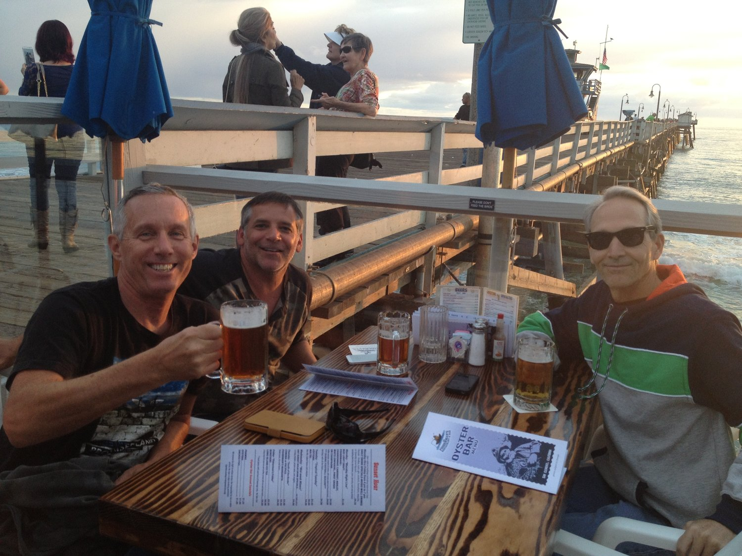 yes, there's even time for a beer and hamburger on the san clemente pier after a day of surfing + yoga!