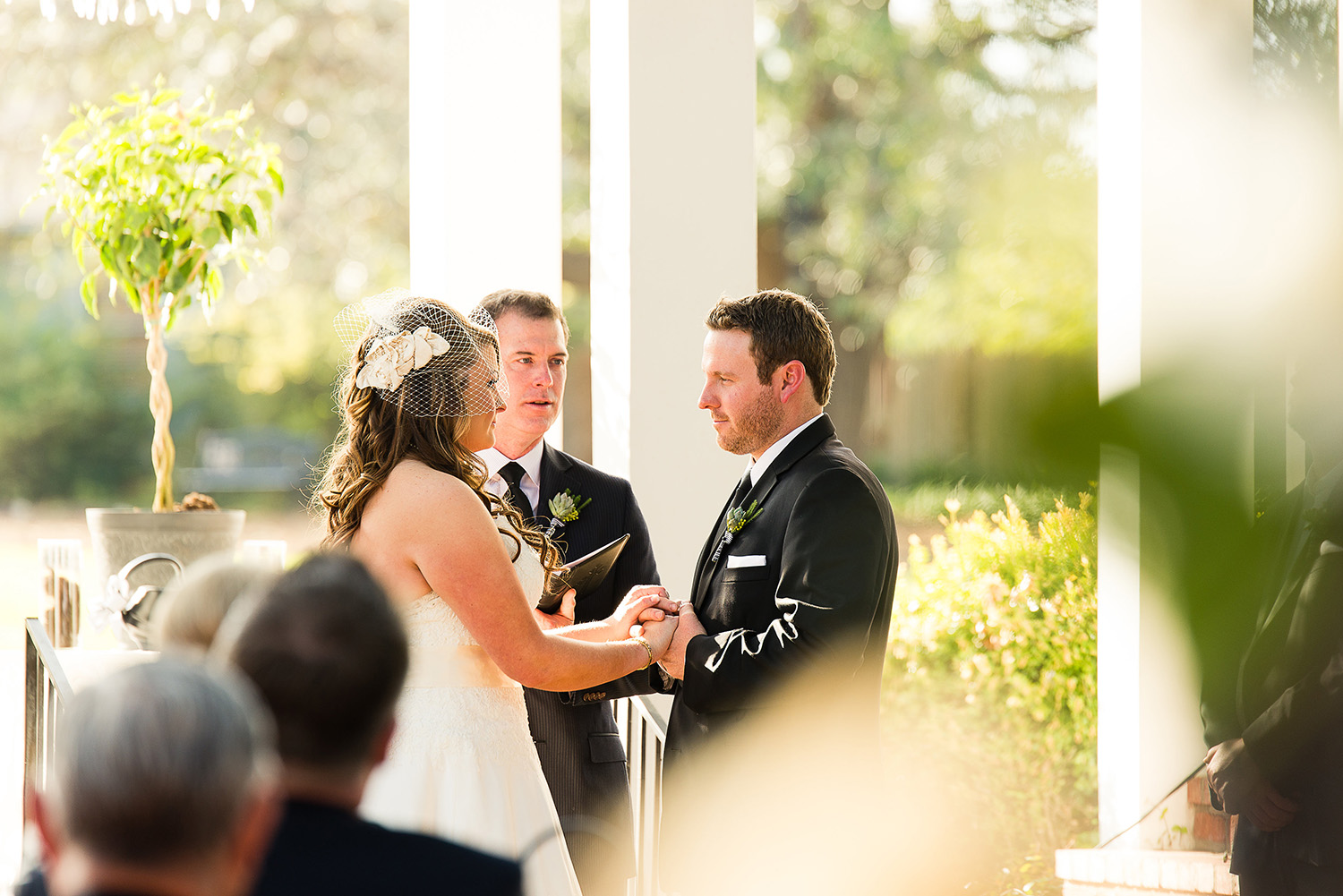 This ceremony was about 2 hours prior to sunset at the end of March. Spring had sprung at this point and there were leaves on the trees and the grass was green. The light was VERY harsh but we lucked out and the couple were under the shadow of the pillars in this beautiful ceremony space.