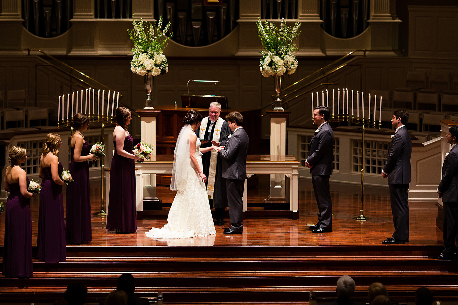 This fall ceremony was indoor after sun had set. All light was coming from directly overhead with the stage lights, which created heavy shadows but also an intimate feel.