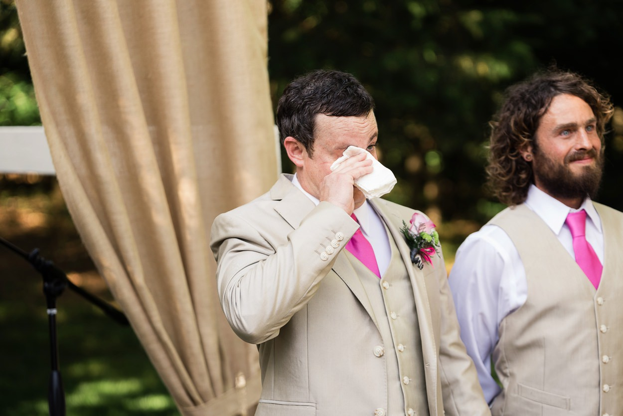 groom crying as bride walks aisle