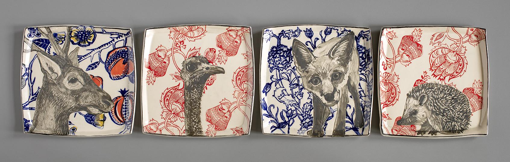 72 elk ostrich fox hedgehog plates.jpg
