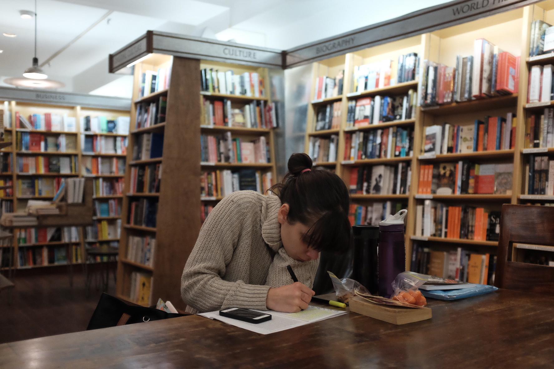 Girl reading in McNally Jackson Books   Photo: Jinglu Huang