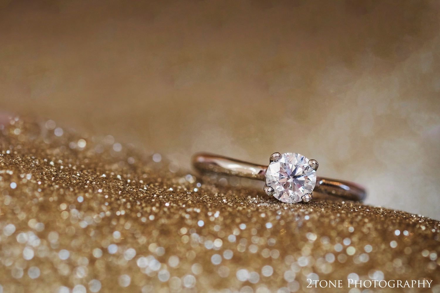 Emma's gorgeous gold wedding shoes made an ideal background for a shot of her stunning engagement ring.