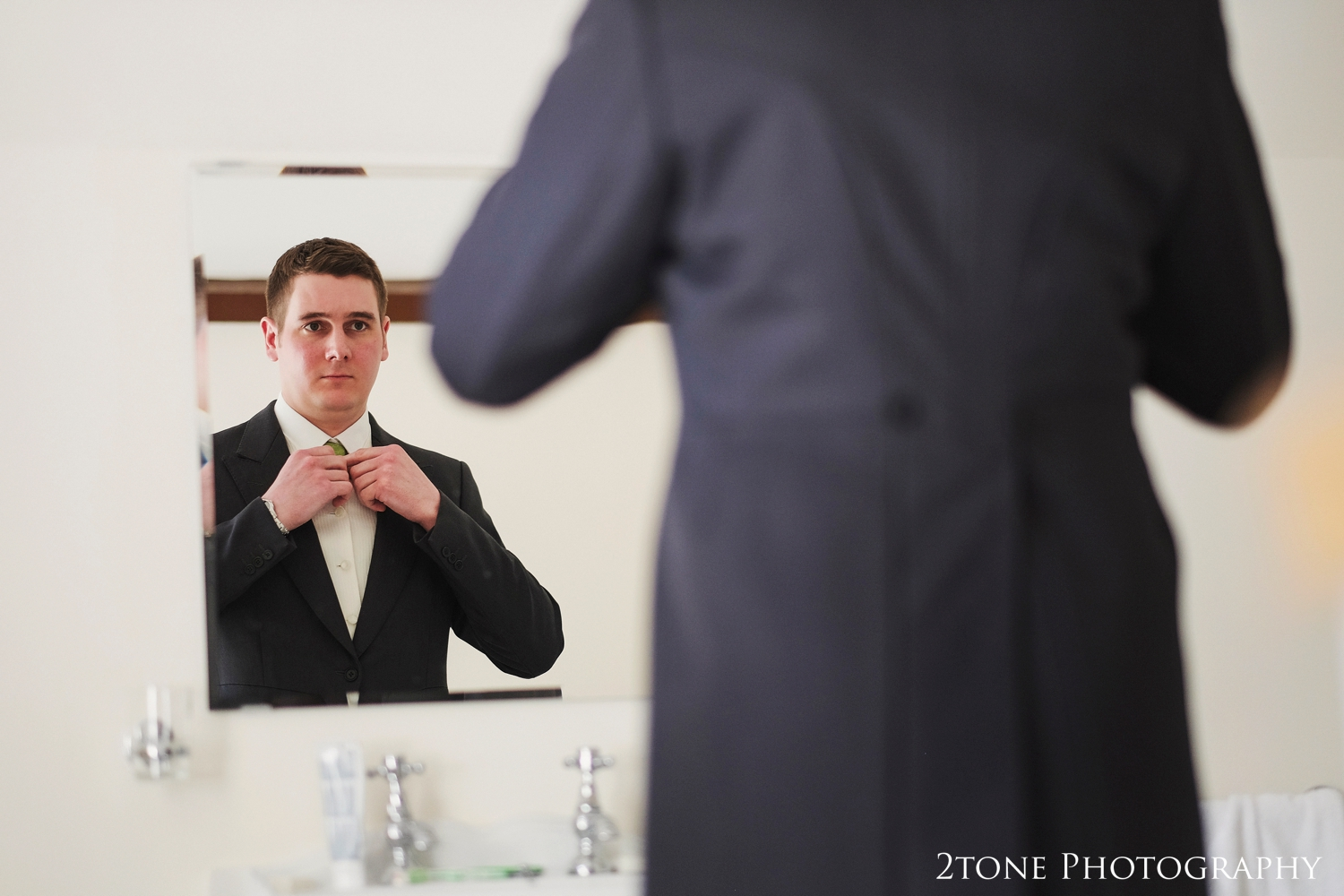 Groom getting ready at Middleton Hall