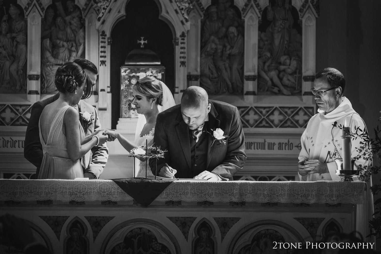 Signing the register, Washington Village church wedding www.2tonephotography.co.uk