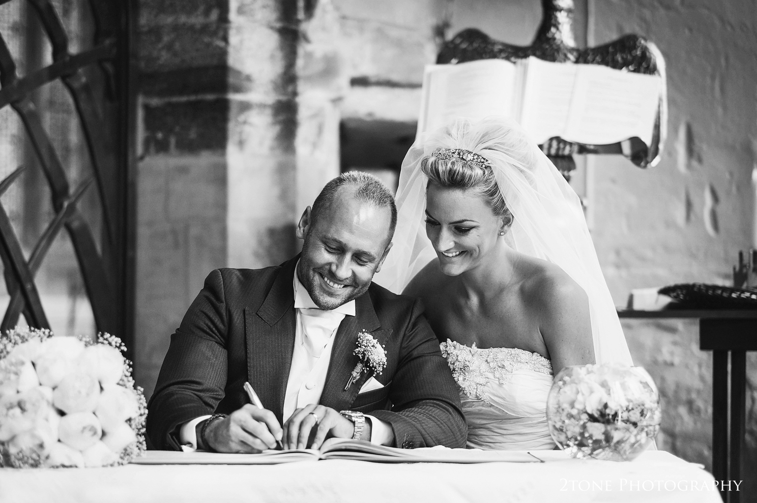 signing the register at St Brandon's church, Brancepeth, Durham.  Wedding photography by www.2tonephotography.co.uk