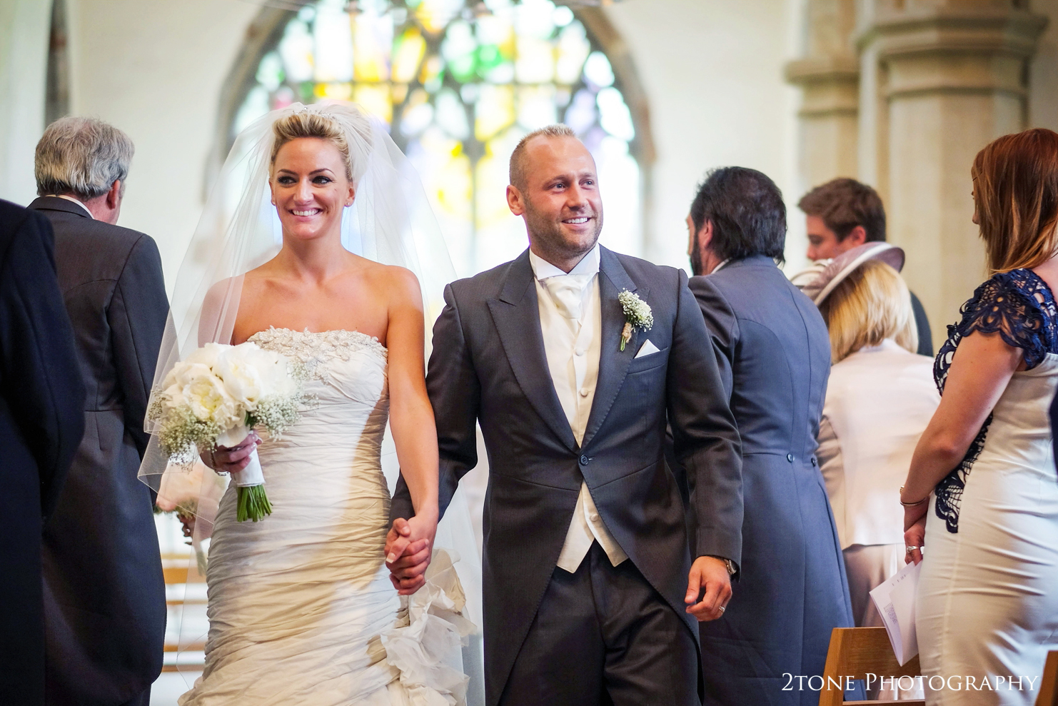 leaving church at St Brandon's church, Brancepeth, Durham.  Wedding photography by www.2tonephotography.co.uk