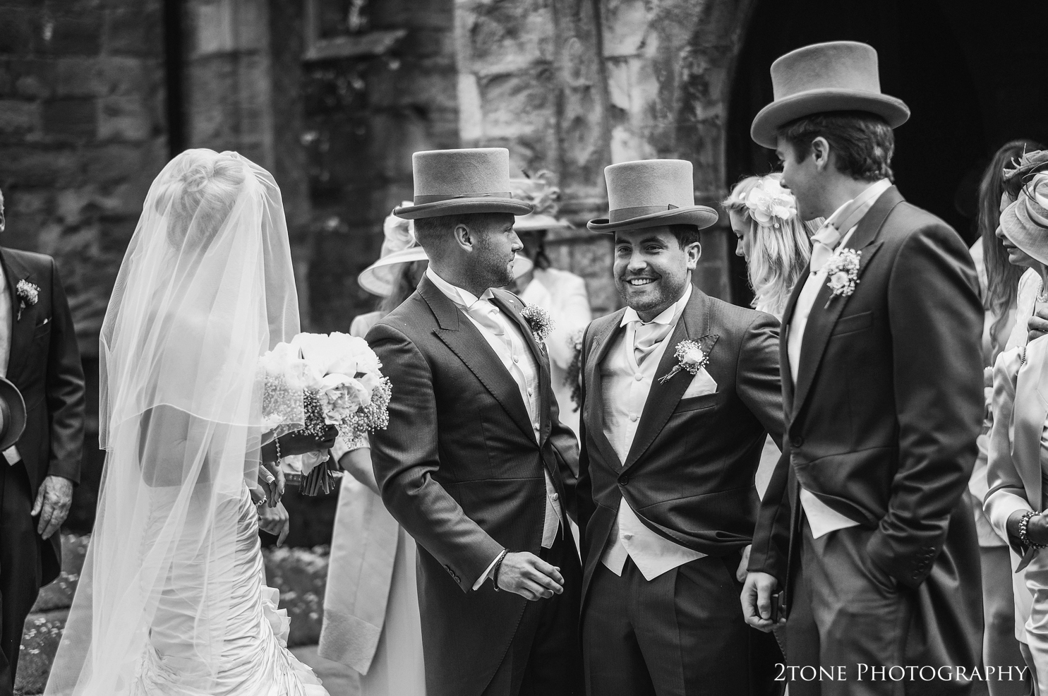 guests greeting the bride and groom at St Brandon's church, Brancepeth, Durham.  Wedding photography by www.2tonephotography.co.uk