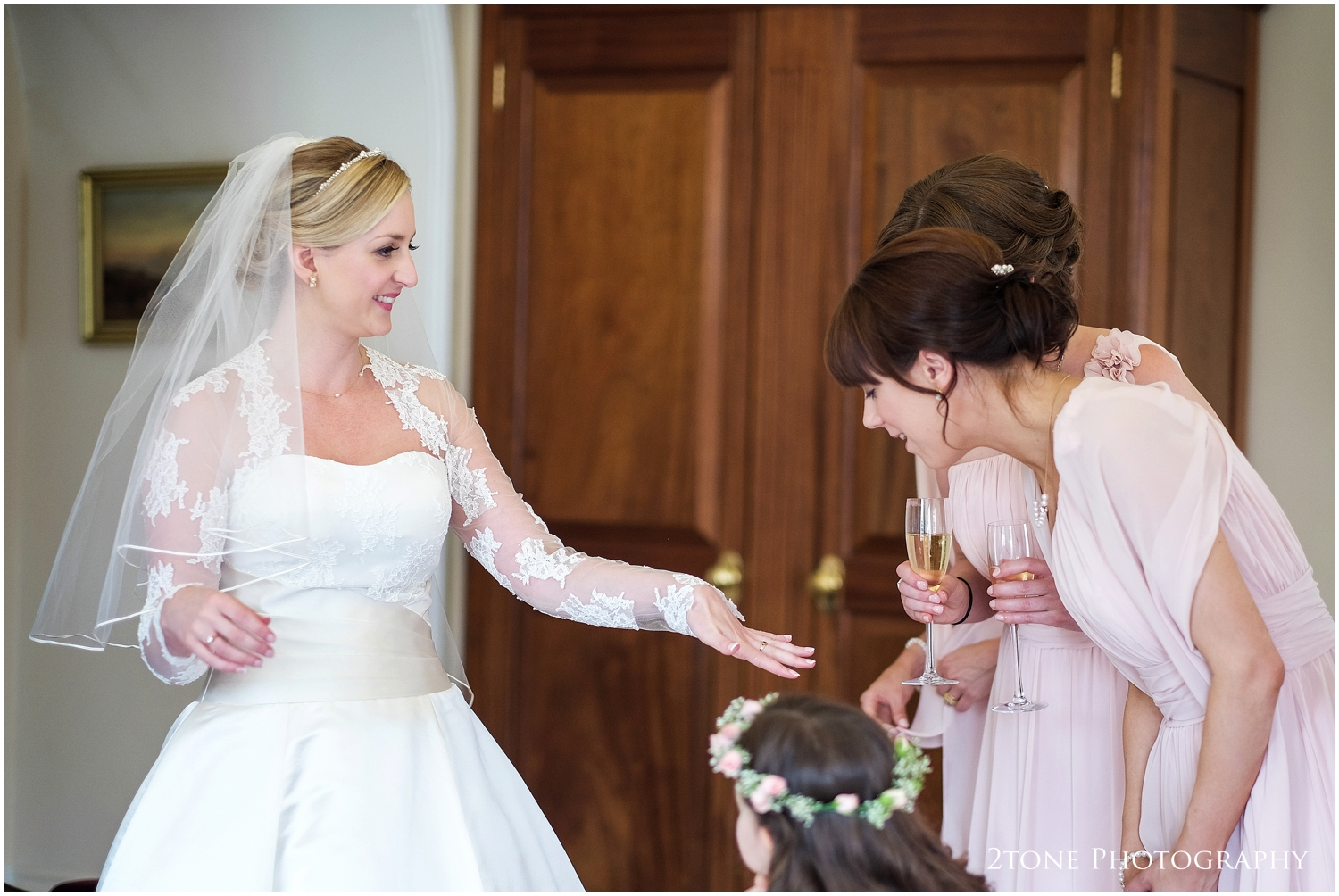 Kristen shows her bridesmaids her new ring, a gift from her parents made especially for her to match herstunning vintage necklace.