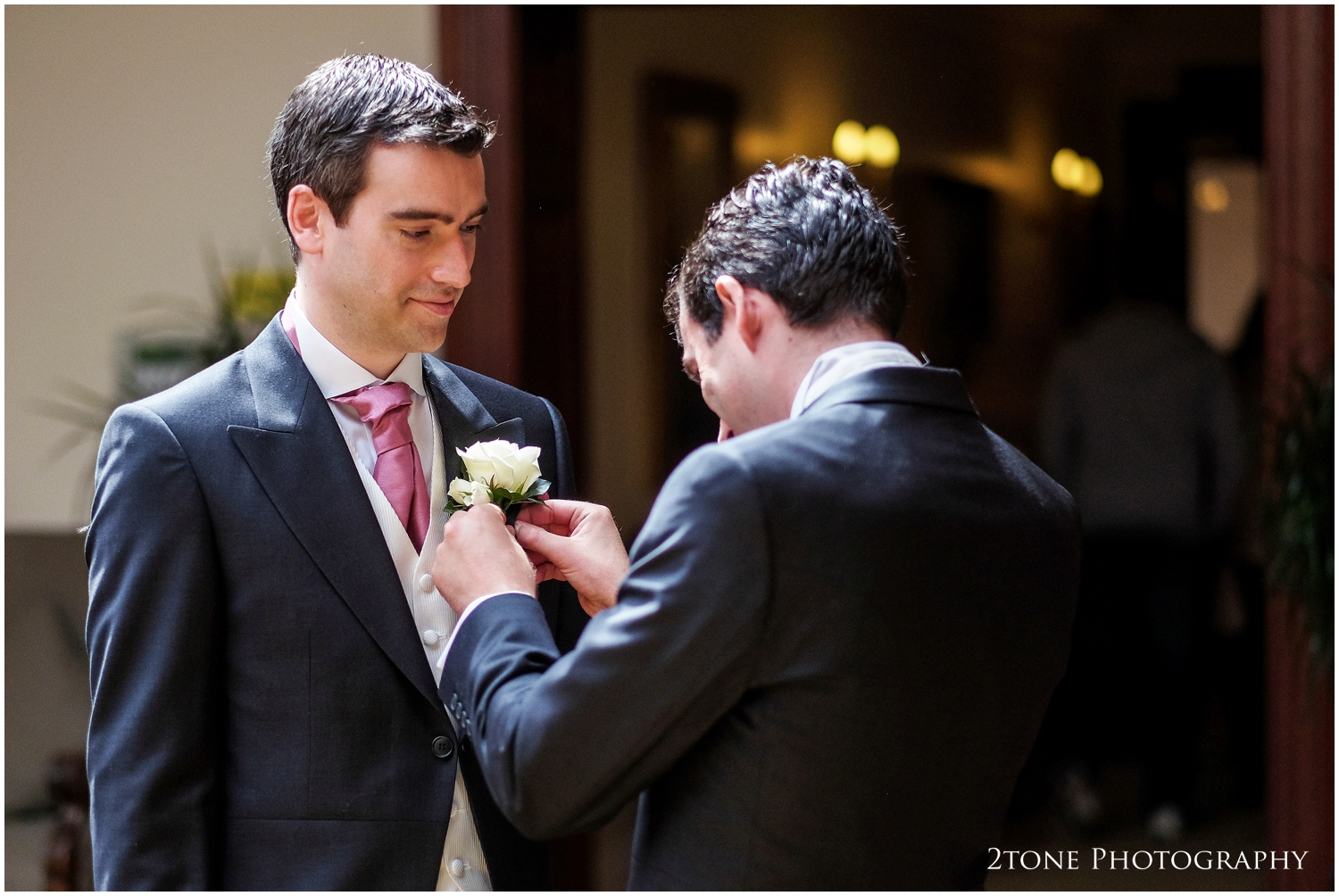 Crisp avalanche roses for the grooms Boutonnière.