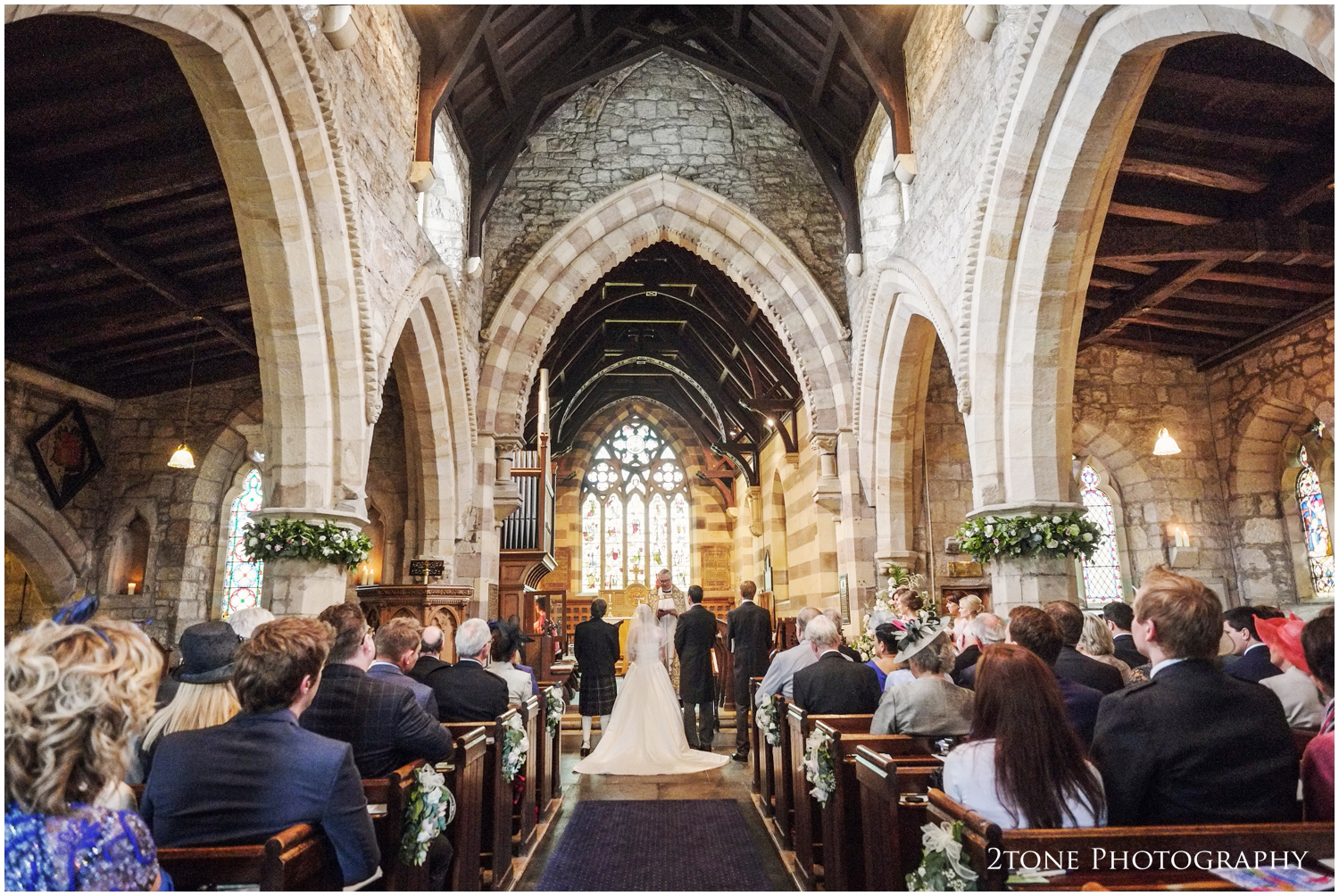 The Holy Trinity Church in Embleton, with it' arched ceilings, timber beams and flowers made to match the bride's bouquet made the perfect setting for a traditional wedding ceremony.