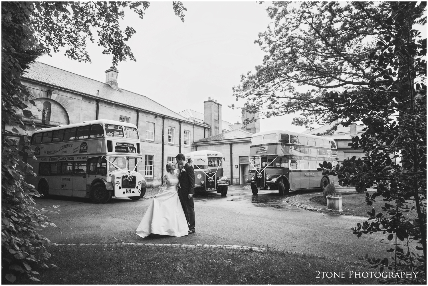 A special request and a quick dash outside to capture Kristen and Innes with the vintage wedding coaches.
