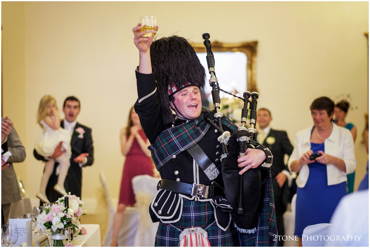 A traditional toast from the piper and the speeches commence.