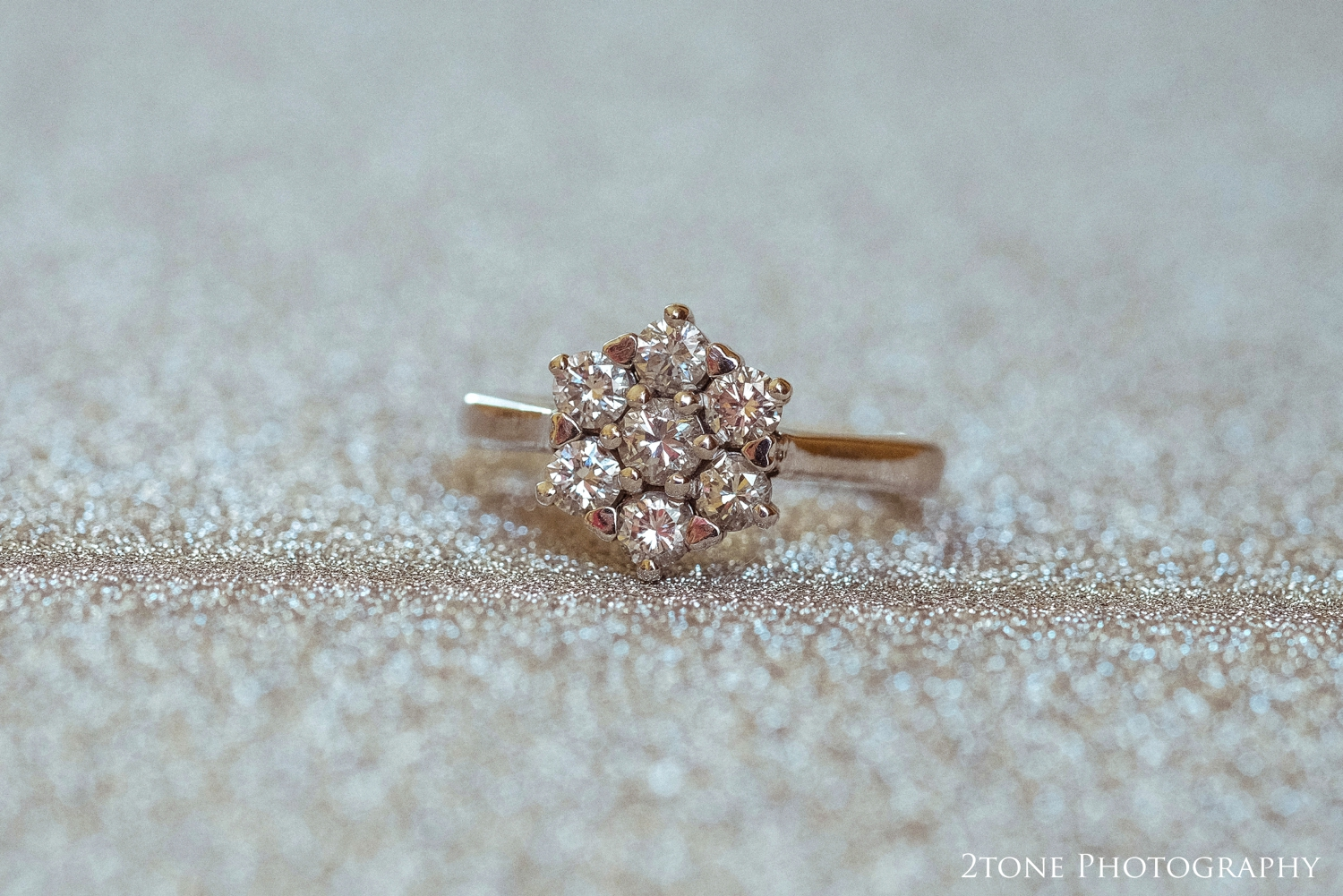 Hannah's stunning seven stone diamond engagement ring set with tiny heart heart shapedclaws.