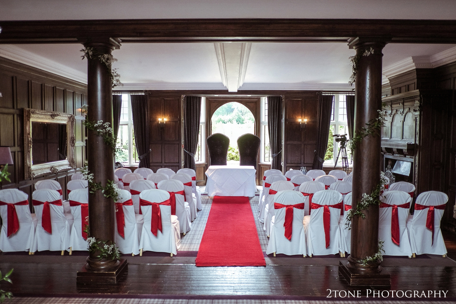 The wedding day took place at Q Hotel's Slaley Hall, near Hexham in Northumberland. In recent years colour trends have been more towards the neutral shades, sages, blush, taupes as well aspurples. It really made a refreshing change to see the room dressed in red and the colour suited the Slaley hall beautifully.