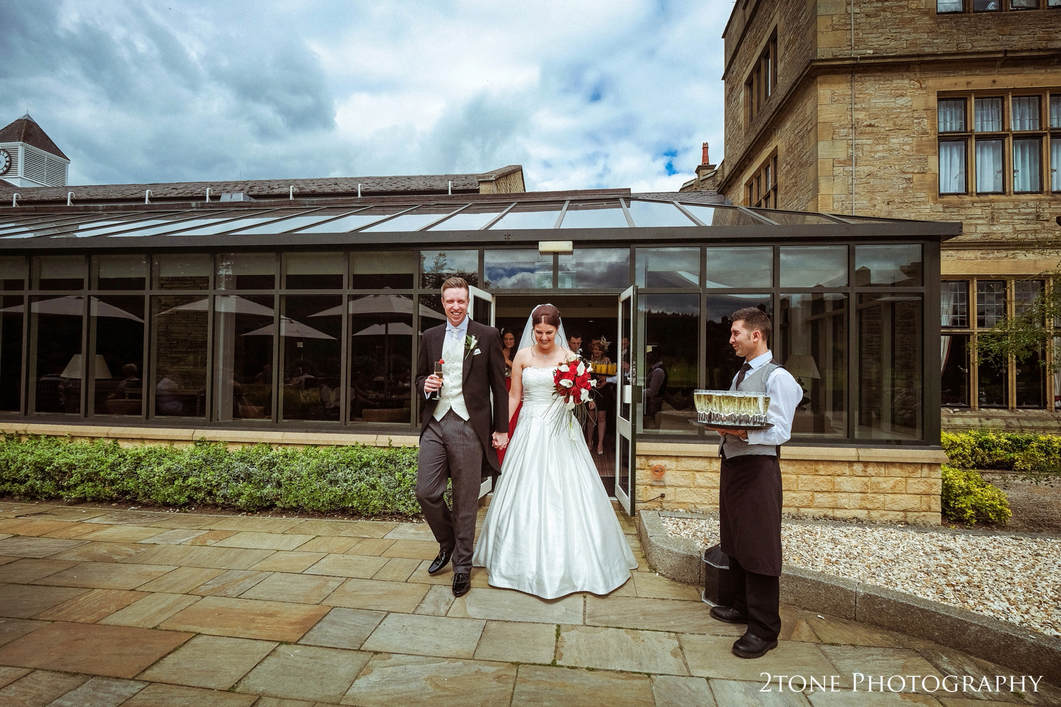 The weather was perfect, sunny but not scorching hot, warm, no wind andso straight after the ceremony they stepped outside to enjoy their drinks reception on the terrace.