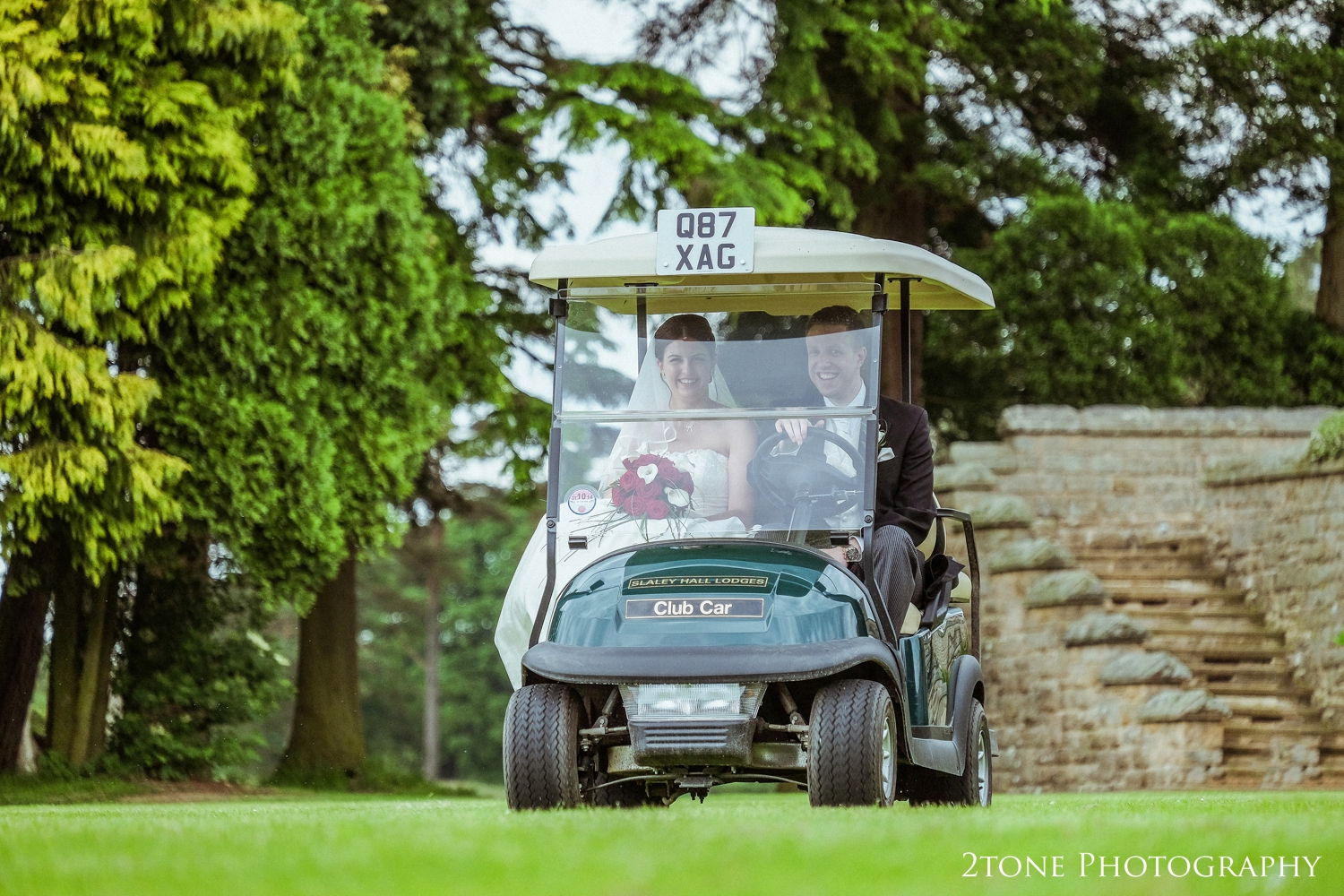 I had managed to get a key for one of Slaley Hall's golfbuggiesfrom the wedding co ordinator and had it hidden in my pocket throughout much of the drinks reception andso when the time came for the four of us to head down to the garden, the buggywas ready and waiting for Paul to drive his bride to have their photographs taken. I gave him the key andPaul grinnedlike a kid in a very large toy shop!!