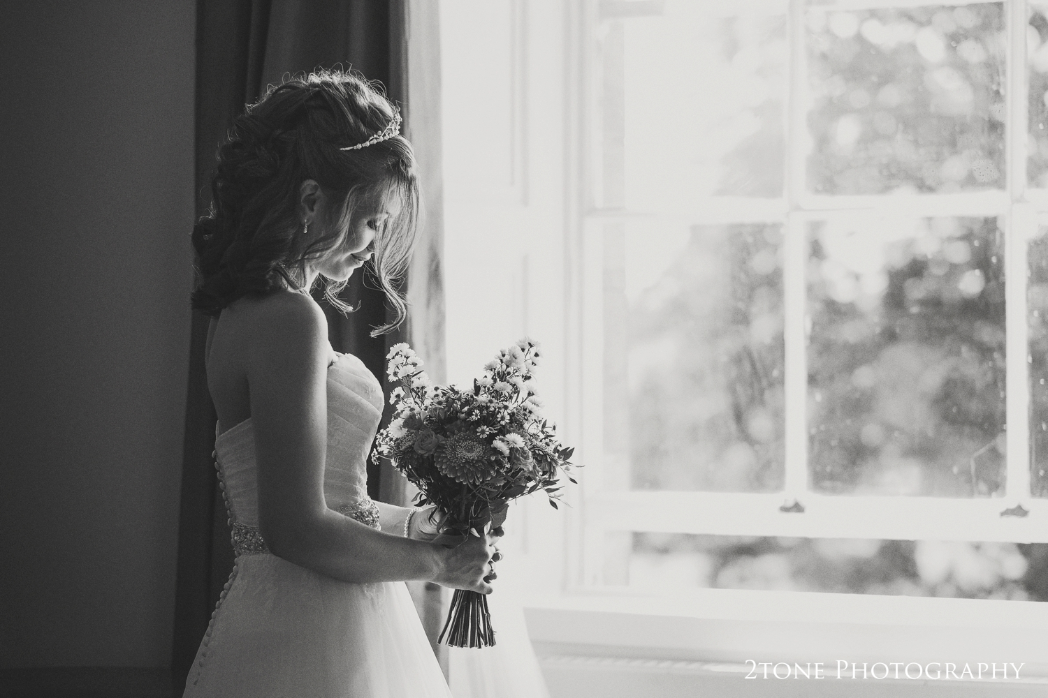 I love this pretty portrait of Nicola standing in the window of the bridal suite of Linden Hall.  The natural light catches her hair as it gently falls over her face, and with a thoughtful smile she is ready for the rest of the day to begin.