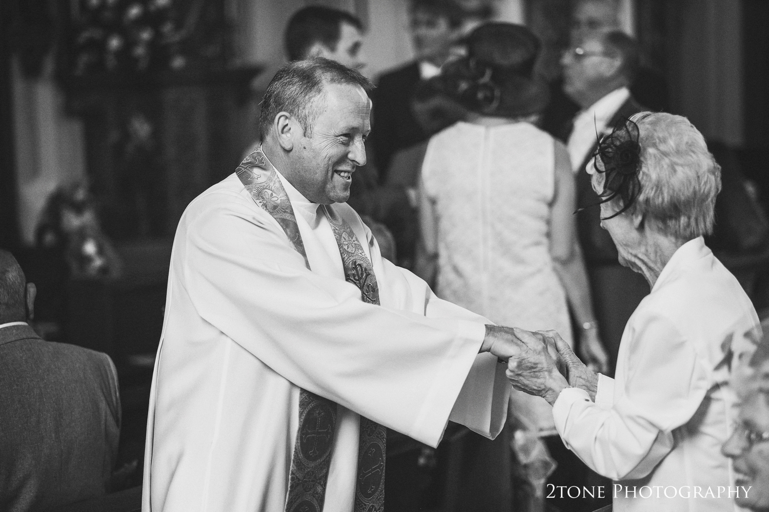 I love this moment, this gesture from the vicar to a member of the family clearly shows how everyone was welcomed open arms into the church.  The atmosphere was warm, inviting and one of love and humility.