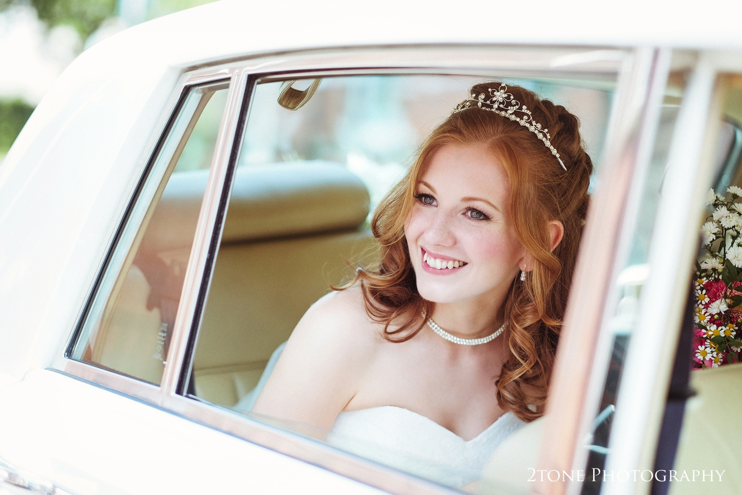 Nicola photographed in her wedding car looks completely stunning.