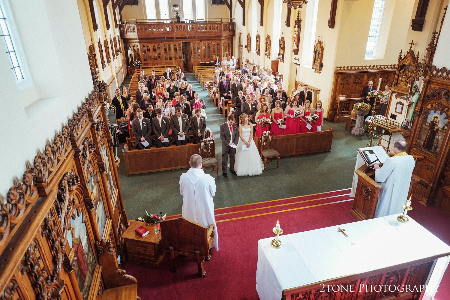 We love to find unusual angle to take photographs from, and this is a great example, setting the scene of this wedding ceremony and allowing us to see really how beautiful St Aidan's church in Ashington really is.