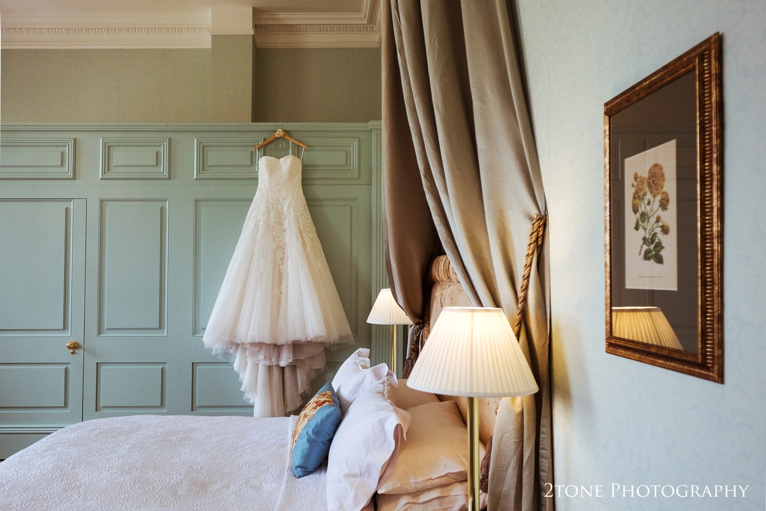 Sonia's stunning wedding gown by Pronovias hanging in Wynyard Hall's Frances Anne suite.