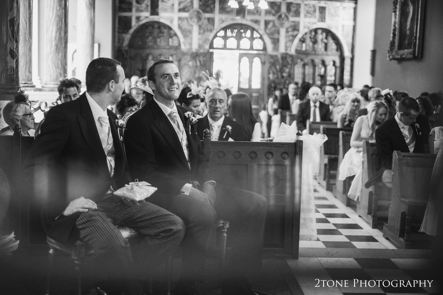The groom waits for the bride's arrival to Wynyard Hall's chapel.  Wedding photography by www.2tonephotography.co.uk