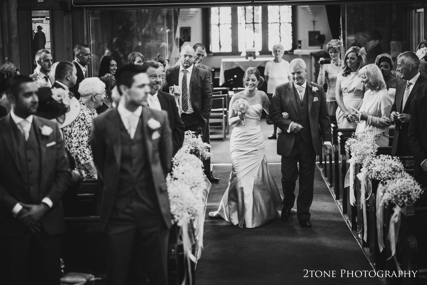 With his daughter on his arm, Laura's dad lead her down the aisle, a proud moment in any fathers life.
