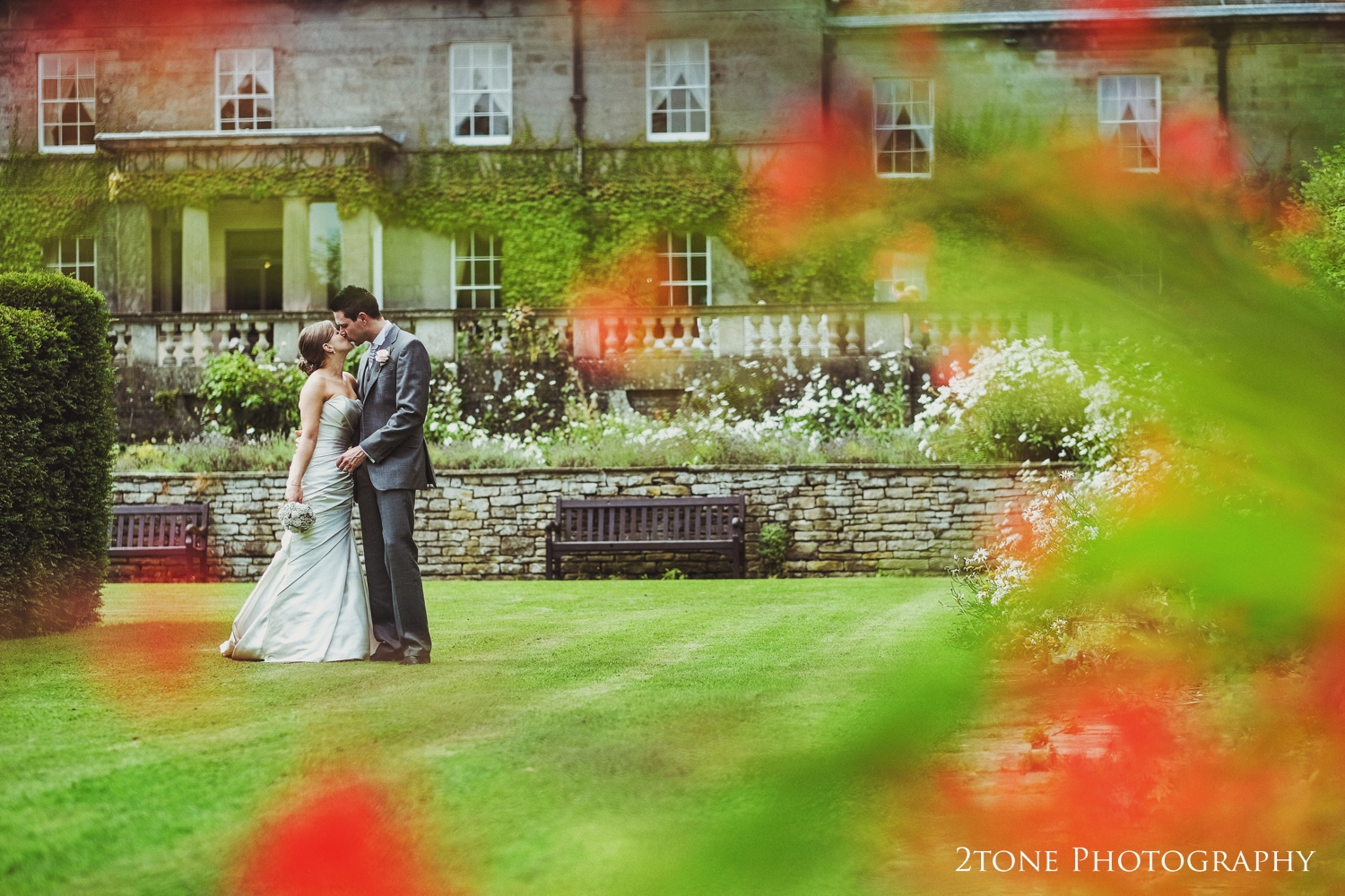 Laura and Simon looking gorgeous in the stunning mature gardens of Doxford Hall.