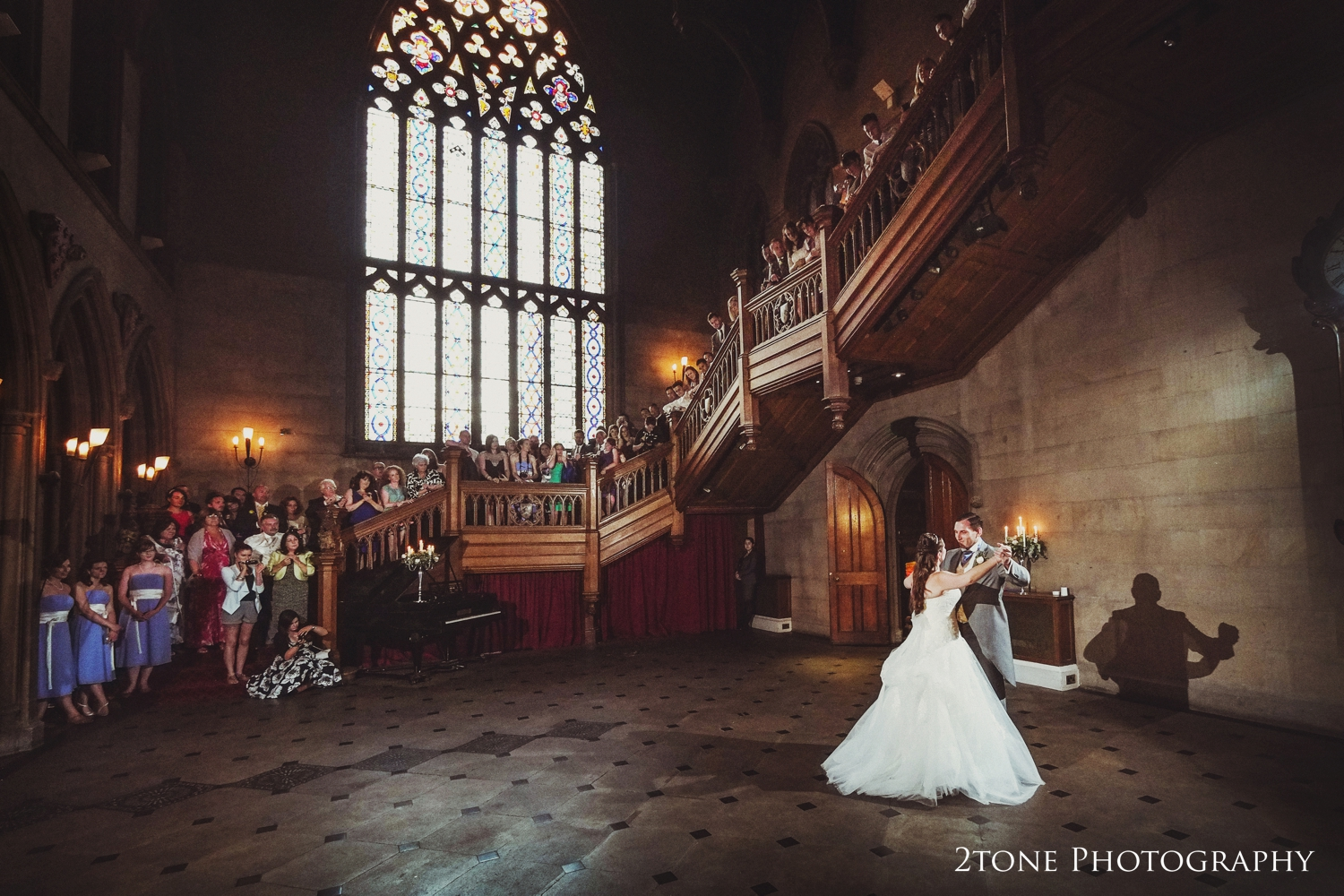 Natalie and Russell's wedding guests were invited on to the grand staircase to welcome Natalie and Russell to take to the dance floor. Natalie and Russell looked incredible as they waltzed across thevast open floor space in the beautiful halllooking like a scene from a fairytale.