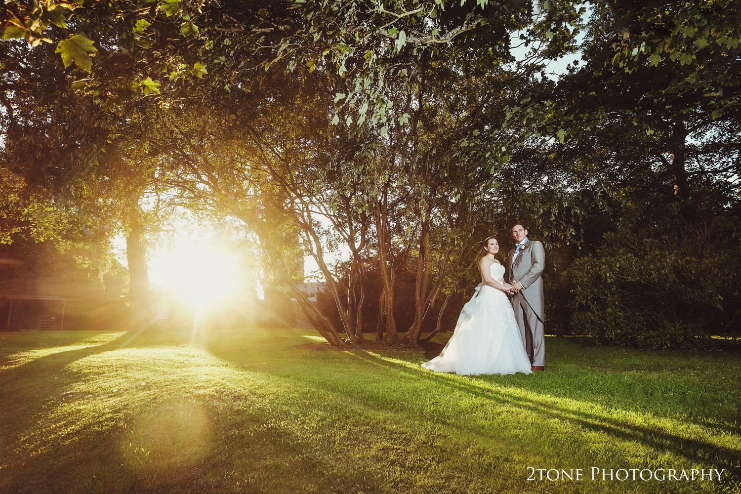 As the sun lowers in the sky, we head outside for one to two last romantic portraits.