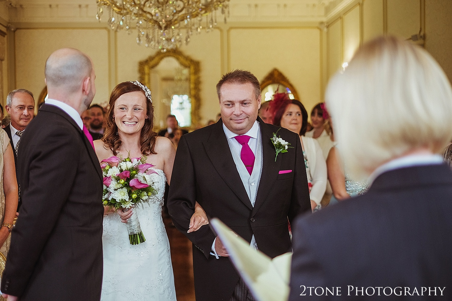 The wedding ceremony was held in one of Lartington Hall's elegant state rooms.  Decorated in gold with opulent chandeliers made it perfect for the occasion.
