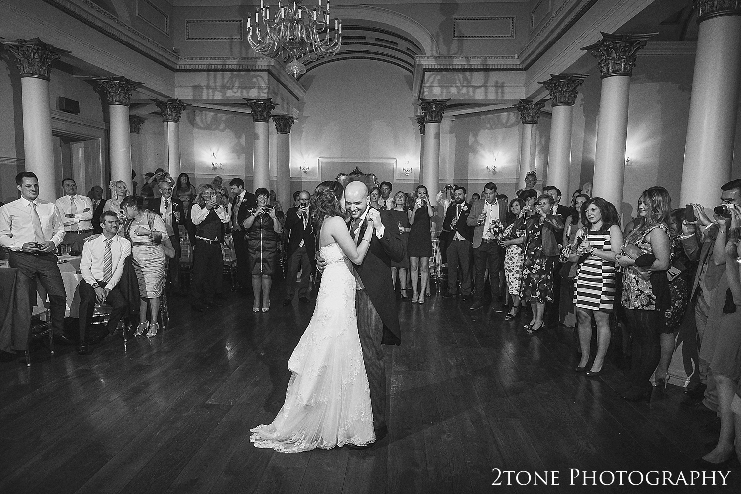Day turns to evening and our couple take to the dance floor for their first dance as man and wife.