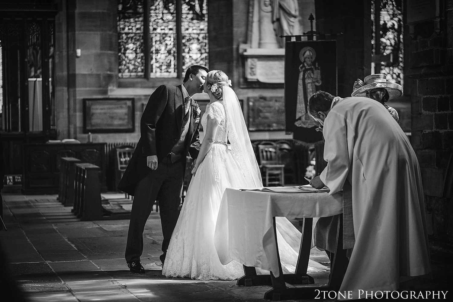 Signing the register at the Cathedral Church of St Nicholas.  Newcastle and Beamish Hall Wedding Photography by www.2tonephotography.co.uk