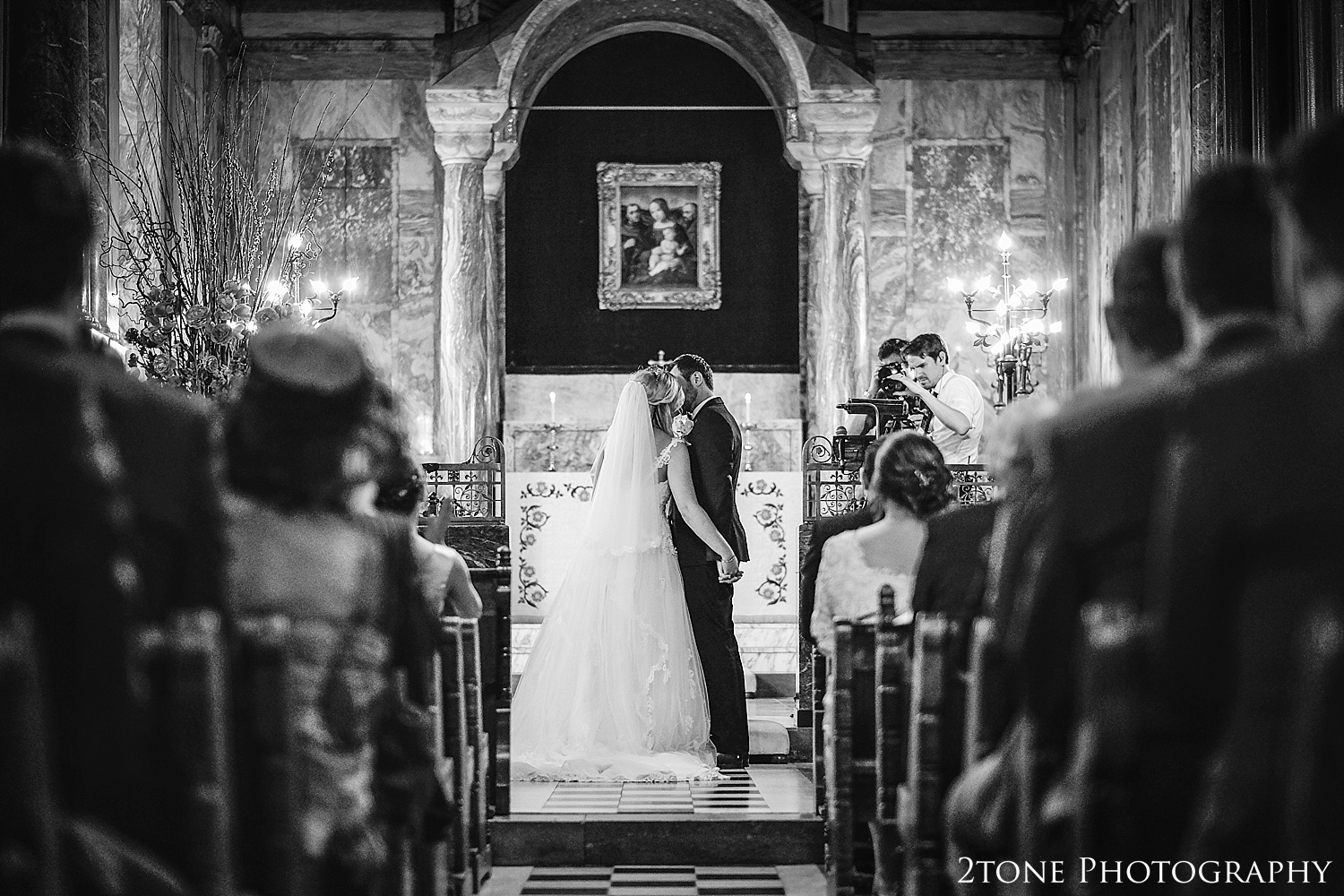 The kiss.  Wynyard Hall wedding photography by www.2tonephotography.co.uk