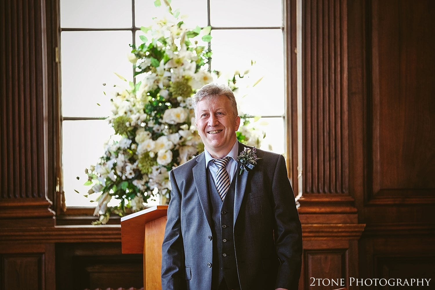 Groom waiting in the Lothian Chambers in Edinburgh by 2tone Photography