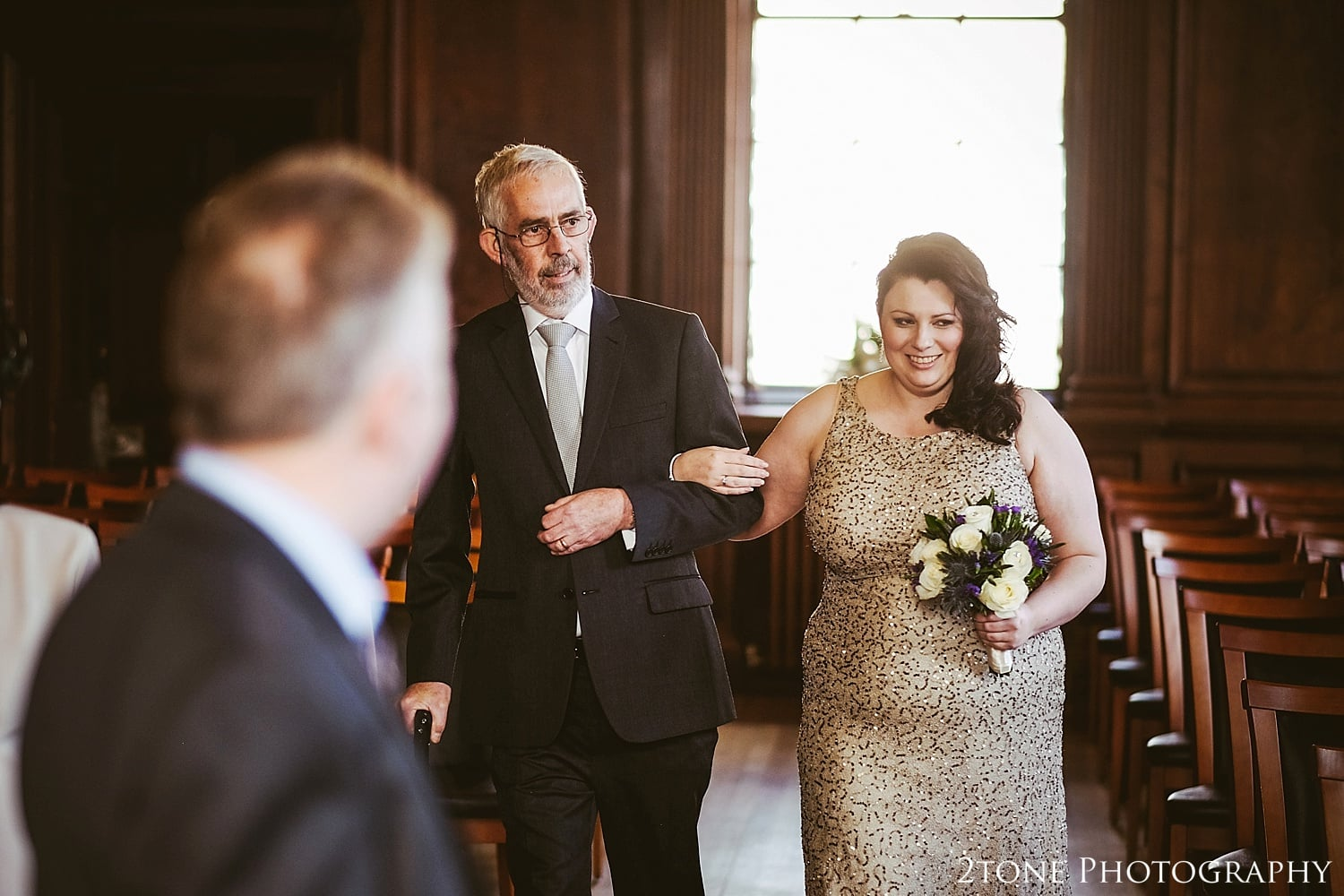 Bride and father process down the aisle.  Wedding Photography at the Lothian Chambers in Edinburgh by 2tone Photography