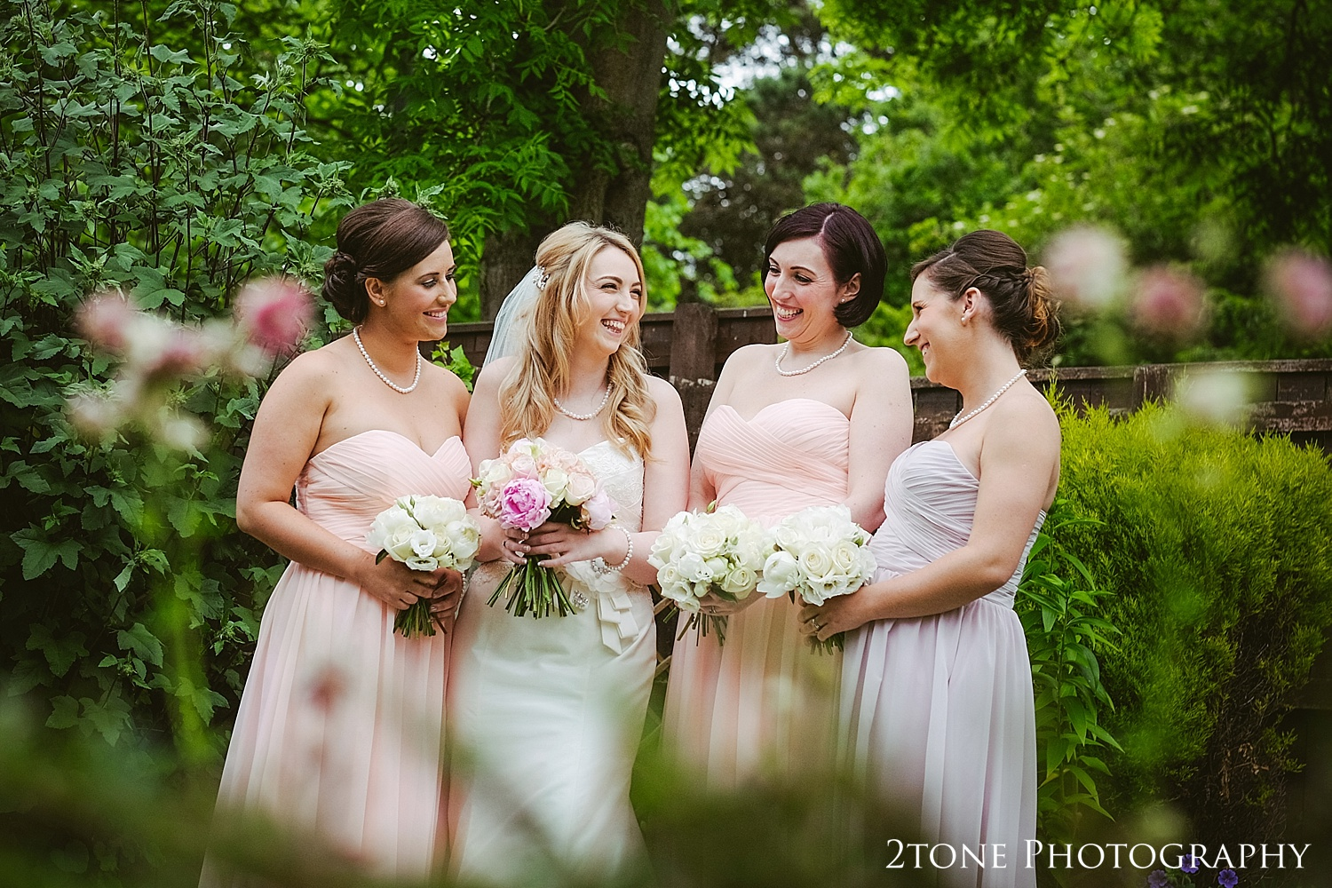 The bride and bridesmaids by www.2tonephotograhy.co.uk